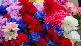 Plastic Flowers in shop display royalty free stock image
