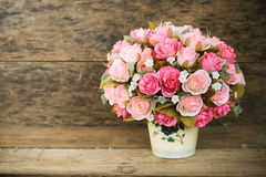 Plastic flowers with wooden background in vintage picture style, home interior equipment, Flowers set on wooden background royalty free stock image