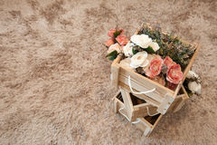 Plastic flowers with wooden boxes. Vintage style royalty free stock photography