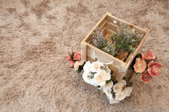 Plastic flowers with wooden boxes. Vintage style stock images
