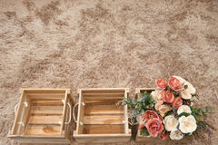 Plastic flowers in wooden boxes. Vintage style royalty free stock photos