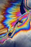 Plastic foil light. An abstract background of thick plastic foil torn and stretched in polarized light Stock Photos