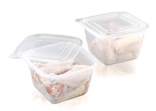 Plastic food storage box whit chiken  on white Royalty Free Stock Photo