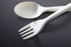 Plastic fork and spoon Royalty Free Stock Photography