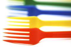 Plastic forks. Of different colors on white background Stock Images