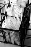 Plastic Forks Holder Basket. Plastic Forks in Holder on Counter Top Stock Photography