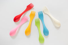 Plastic forks and spoons on White Background Stock Photos
