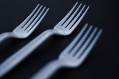 Plastic forks. On top of black background Stock Photo