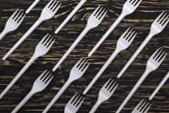 Plastic forks on wooden background Stock Photo