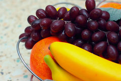 Plastic Fruit. Bananas, apples and grapes close-up Royalty Free Stock Image