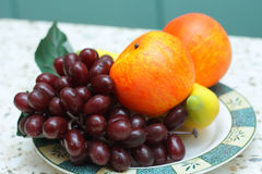 Plastic Fruit. Bananas, apples and grapes close-up Royalty Free Stock Photography