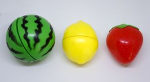 Plastic vegetables and fruits. Plastic fruits in colors of traffic lights Stock Images