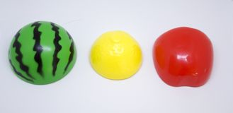 Plastic vegetables and fruits. Plastic fruits in colors of traffic lights Royalty Free Stock Photography