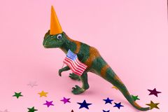 Plastic funny green dinosaur. With USA flag royalty free stock photography