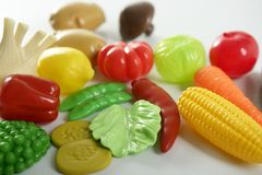 Plastic game, fake varied vegetables and fruits Royalty Free Stock Photos