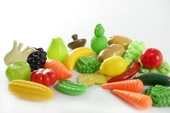 Plastic game, fake varied vegetables and fruits Stock Photos