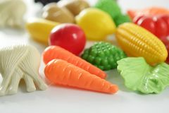 Plastic game, fake varied vegetables and fruits Royalty Free Stock Photography