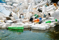Plastic garbage. River waters polluted by plastic garbage Royalty Free Stock Images