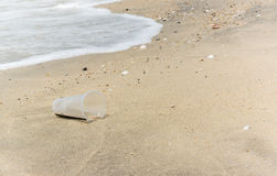 Plastic garbage on the beach Royalty Free Stock Image