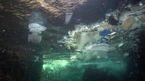 Plastic garbage and other debris floating underwater. Marine pollution. Plastic debris in the water, killing wildlife. Black Sea, Bulgary stock video footage