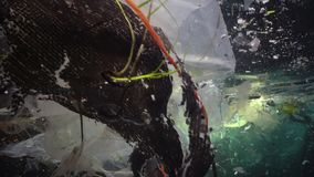 Plastic garbage and other debris floating underwater. Marine pollution. Plastic debris in the water, killing wildlife. Black Sea, Bulgary stock footage