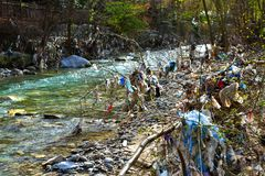 Plastic Garbage Polution in mountain stream Royalty Free Stock Photography