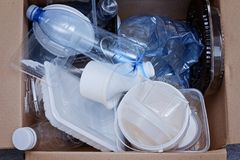 Plastic garbage prepared for recycling top view. Plastic garbage in a carton prepared for recycling top view Royalty Free Stock Image