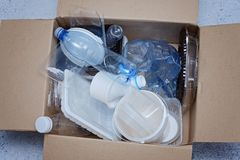 Plastic garbage prepared for recycling top view. Plastic garbage in a carton prepared for recycling top view Stock Photos