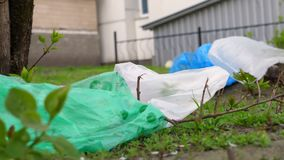 Plastic garbage on a street. Pollution of environment by waste. Plastic garbage on the street. Pollution of environment by waste stock footage