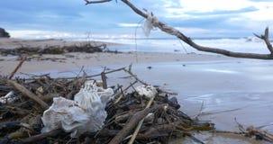 Plastic garbage waste water pollution on beach by ocean sea stock video footage