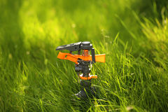 Plastic garden splinkter. Standing on the groud in the gazon grass Royalty Free Stock Images