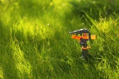 Plastic garden splinkter. Standing on the groud in the gazon grass Royalty Free Stock Photos