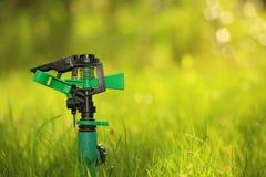 Plastic garden splinkter. Standing on the groud in the gazon grass Stock Images
