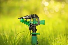 Plastic garden splinkter. Standing on the groud in the gazon grass Stock Photography