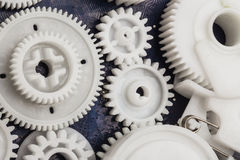 The plastic gear. Photo fragment of machine Stock Images