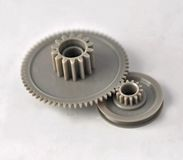 Plastic Gears. Two gray plastic gears closeup Royalty Free Stock Photos