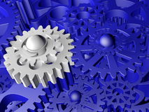 Plastic gears in blue and white colors. In backgrounds Royalty Free Stock Image