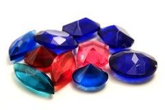 plastic gemstones Arkivfoto