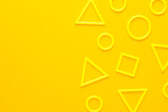 Plastic geometric shapes. Photo of different 3d printed plastic geometric shapes on yellow background Royalty Free Stock Image