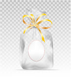 Plastic gift bag with gold shiny ribbon Royalty Free Stock Photography