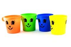 Plastic glas kleurrijk in geïsoleerd stock afbeelding