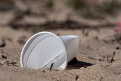 Plastic glass. A plastic glass in a beach sand Stock Image