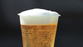 Plastic glass with beer stock video footage