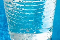 Plastic glass or cup of cold water with drops. Drink of health freshness aqua concept Stock Images