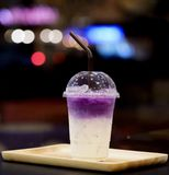 Plastic glass of iced sweet purple potato latte royalty free stock images