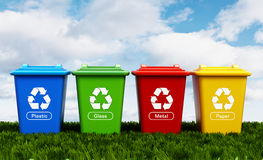 Plastic, glass, metal and paper recycle bins Stock Images