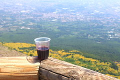 Plastic glass with red wine on top of Mount Vesuvius. Royalty Free Stock Images