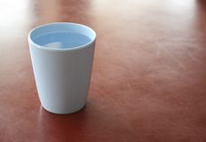 Plastic glass of water Stock Photography
