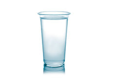 Plastic glass of water isolated on a white background. Royalty Free Stock Images