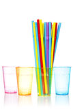Plastic glasses and bunch of colorful straws Royalty Free Stock Photography